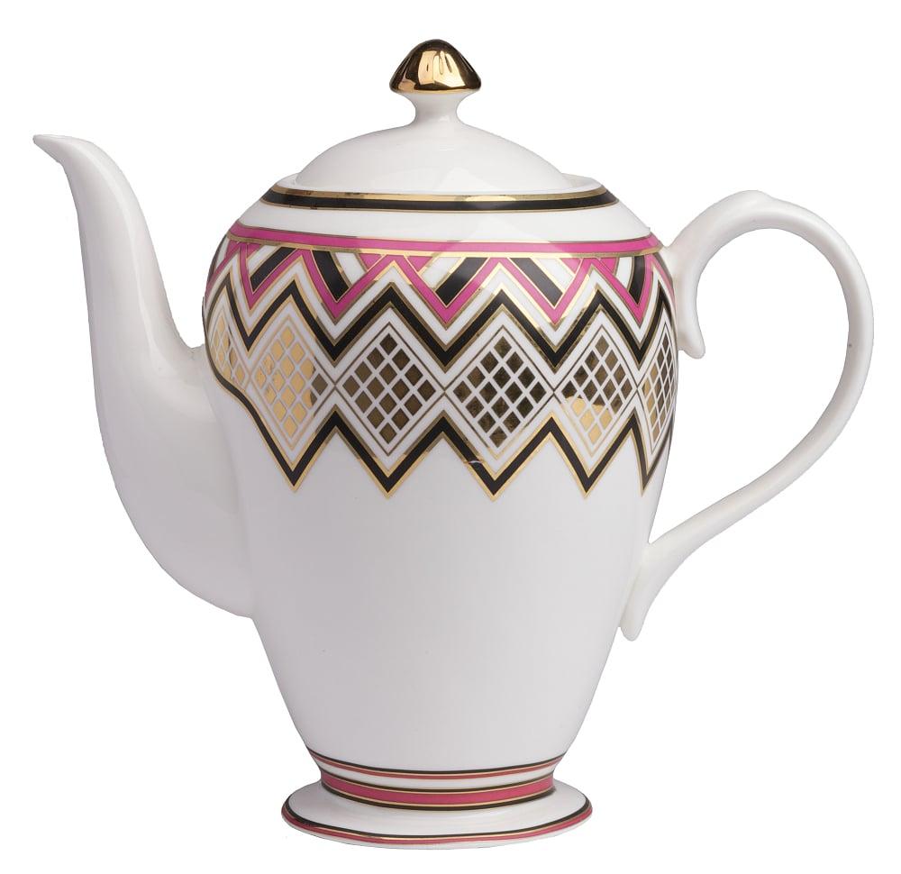 Заварной чайник ExoticЧайники<br>Заварной чайник Exotic выполнен из керамики. <br>Декором служит яркое изображение геометрического <br>орнамента. Чайник можно приобрести отдельно, <br>а также совместно с другими предметами <br>коллекции.<br><br>Цвет: Орнамент<br>Материал: Грубая керамика<br>Вес кг: 1,4<br>Длина см: 34<br>Ширина см: 15,7<br>Высота см: 28