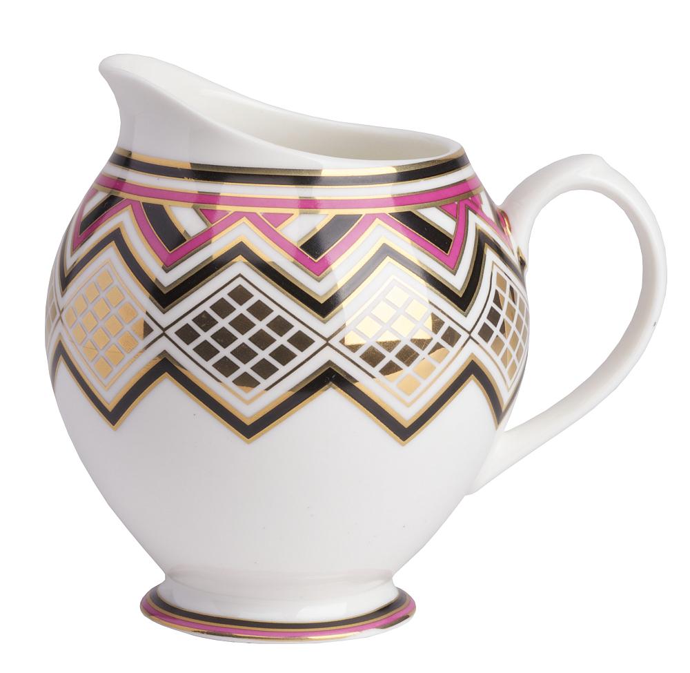 Молочник ExoticМолочники<br>Керамический молочник декорирован в современном <br>стиле, строгим геометрическим орнаментом, <br>прорисованный яркими красками. Декор красиво <br>согласован с формой молочника. Молочник <br>можно приобрести отдельно, а также совместно <br>с другими предметами коллекции.<br><br>Цвет: Орнамент<br>Материал: Грубая керамика<br>Вес кг: 0,6<br>Длина см: 14<br>Ширина см: 9,6<br>Высота см: 10,5