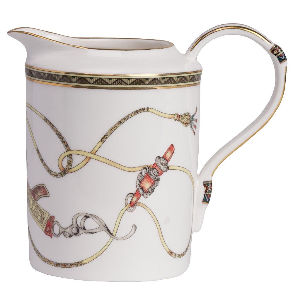 Молочник EmpireМолочники<br>Чай со сливками или молоком полезен — это <br>известно давно. Церемония чаепития с красивой <br>сервировкой становится торжественной и <br>поднимает настроение. Изящный молочник <br>Empire, безусловно, необходим к чайному сервизу <br>соответствующей коллекции. Отличительным <br>признаком дизайна коллекции Empire являются <br>уникальные стилизованные образы скакунов <br>и конской сбруи, украшающих эту великолепную <br>фарфоровую посуду. Прекрасный подарок любителю <br>лошадей и конного спорта.<br><br>Цвет: Разноцветный<br>Материал: Грубая керамика<br>Вес кг: 0,2<br>Длина см: 14<br>Ширина см: 9<br>Высота см: 12