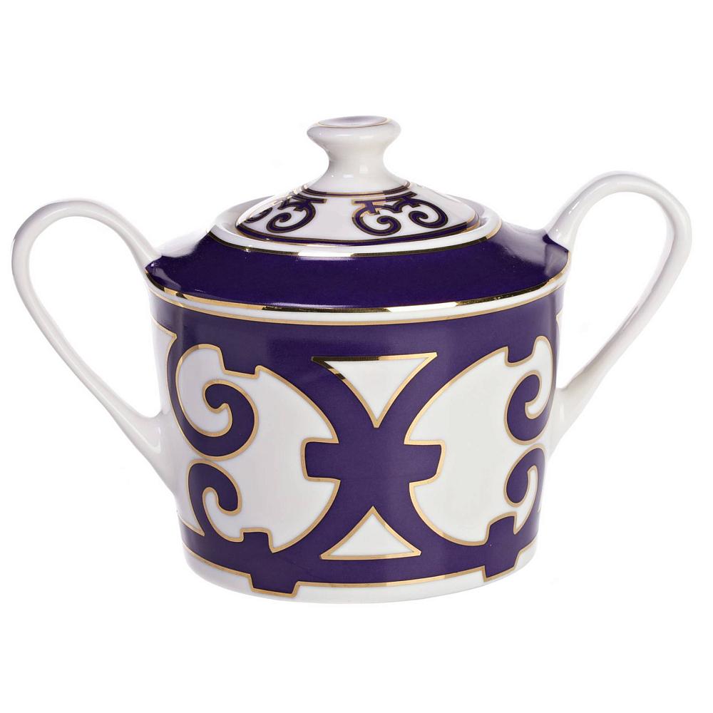 Сахарница Violet DreamsСахарницы<br>Сахарница как непременный атрибут чаепития <br>появилась в Европе в начале 16-го века. Когда-то <br>она выглядела как круглая емкость, накрывавшаяся <br>блюдцем. С тех пор дизайн сахарницы претерпел <br>существенные изменения: появилась крышка, <br>ручки и даже форма изделия теперь ограничена <br>лишь фантазией дизайнера. Сахарница «Violet <br>Dreams» имеет классическую круглую форму, <br>изящные ручки и украшена великолепным орнаментом <br>из причудливо переплетенных линий. Изделие <br>выполнено из тончайшего костяного фарфора <br>и станет прекрасным дополнением к другим <br>предметам для чаепития серии «Violet Dreams».<br><br>Цвет: Белый, Фиолетовый<br>Материал: Костяной фарфор<br>Вес кг: 0,2<br>Длина см: 16<br>Ширина см: 10<br>Высота см: 11