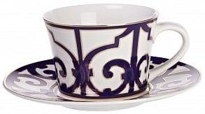 Чайная пара Violet DreamsЧайные пары<br>Великолепная чайная пара из белоснежного <br>костяного фарфора серии «Violet Dreams» выполнена <br>с большой любовью и вкусом. Изделие декорировано <br>оригинальным фиолетовым орнаментом в стиле <br>восточных арабесок и украшено позолоченным <br>кантом. Вы можете приобрести чайную пару <br>отдельно, а также вместе с другими предметами <br>серии «Фиолетовые сны».<br><br>Цвет: Белый, Фиолетовый<br>Материал: Костяной фарфор<br>Вес кг: 0,3<br>Длина см: 9<br>Ширина см: 9<br>Высота см: 6