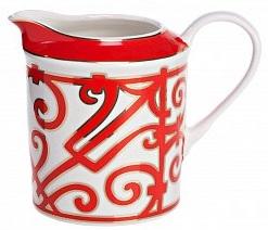 Молочник HeritageМолочники<br>Эффектный и яркий молочник коллекции «Heritage» <br>(Наследие) дополнит сервировку классической <br>чайной церемонии. Традиция пить чай с молоком <br>издревле существовала и в европейских, <br>и в восточных странах. Считается, что в Россию <br>этот обычай пришел из Англии, где five oclock <br>tea стал визитной карточкой страны. И хотя <br>знатоки спорят о рецепте идеального чая <br>– добавлять ли чай в молоко или молоко в <br>чай – в одном они сходятся – чай с молоком, <br>безусловно, приобретает изысканный и богатый <br>вкус. Молочник «Heritage» выполнен из превосходного <br>костяного фарфора и декорирован оригинальным <br>орнаментом алого цвета в стиле модерн (moderne). <br>Изящная ручка и удобный носик делают использование <br>молочника удобным и приятным. Как и другие <br>изделия серии, вы можете приобрести его <br>отдельно или в составе сервиза.<br><br>Цвет: Красный,белый<br>Материал: Костяной фарфор<br>Вес кг: 0,2<br>Длина см: 14<br>Ширина см: 9<br>Высота см: 12