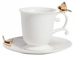 Чайная пара BejaflorЧайные пары<br>Чайная пара Bejaflor — это белоснежная керамика, <br>лучшее качество от производителя, элегантность <br>формы. Золотые бабочки, присевшие на изящную <br>ручку чашки и край блюдца, заставляют влюбиться <br>в эту пару с первого взгляда.<br><br>Цвет: Белый, Золото<br>Материал: Керамика<br>Вес кг: 0,2<br>Длина см: 15<br>Ширина см: 15<br>Высота см: 10
