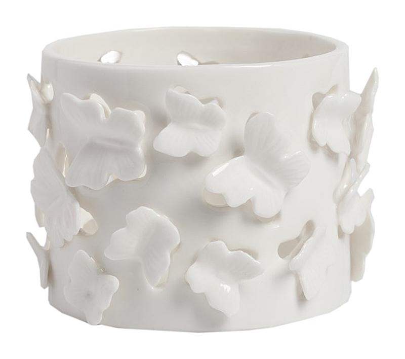 Декоративная ваза CharmingВазы<br>Декоративная ваза Charming — это изысканный <br>и очаровательный элемент декора вашего <br>дома, который наполнит его теплом, уютом, <br>сделает более роскошным и оригинальным. <br>Прелестные милые бабочки из керамики, которыми <br>декорирован аксессуар, непременно понравятся <br>всем членам вашей семьи. Украсьте дом такой <br>вазочкой, и любая его комната заиграет по-новому, <br>даря вам только хорошее настроение.<br><br>Цвет: Белый<br>Материал: Керамика<br>Вес кг: 0,2<br>Длина см: 8<br>Ширина см: 8<br>Высота см: 6,5