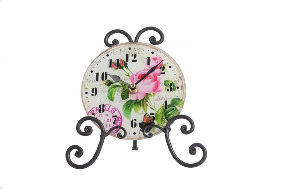 Часы на подставке AnikaЧасы<br>Роскошный интерьер складывается из деталей. <br>Часы на подставке Anika — это тот элемент <br>декора, который непременно привнесет в <br>ваш дом дополнительный уют, красоту и изысканность. <br>Необычное сочетание стеклянного циферблата <br>и кованой металлической подставки дает <br>поистине оригинальный аксессуар. Растительные <br>мотивы, украшающие часы, будут отлично гармонировать <br>с общей картиной помещения, оформленного <br>в любом стиле.<br><br>Цвет: Разноцветный<br>Материал: Стекло, Металл, Часовой механизм<br>Вес кг: 0,3<br>Длина см: 20,5<br>Ширина см: 21,5<br>Высота см: 9,6