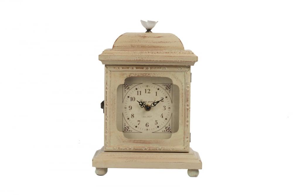 Настольные часы HolmesЧасы<br>Настольные часы Holmes будет служить вам как <br>по назначению, так и для хранения ценных <br>вещей. Циферблат встроен в искусственно <br>состаренную деревянную дверцу, а за ней <br>— потайной ящичек для мелких предметов. <br>Сам аксессуар смотрится весьма изысканно <br>и мило, что позволяет ему вписаться в любую <br>комнату, оформленную в стиле Прованс. Наполните <br>уютом и теплом ваш дом.<br><br>Цвет: Бежевый<br>Материал: МДФ, Стекло и часовой механизм<br>Вес кг: 2<br>Длина см: 23<br>Ширина см: 13<br>Высота см: 33