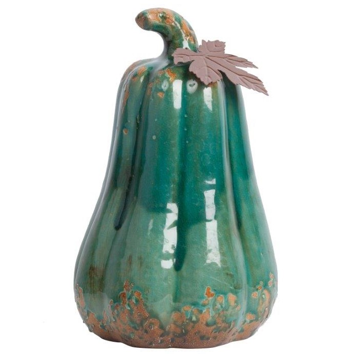 Предмет декора статуэтка тыква Arbusto Aqua DG-HOME Элемент декора Arbusto Aqua — это уникальное  и ни с чем несравнимое украшение вашего  дома, которое привнесет в него яркость,  игривость, очарование и шик. Аксессуар изготовлен  из керамики, имеет приятный зелёный цвет  и лаковое покрытие сверху. Это позволяет  ему не только гармонично вписаться в общую  картину, но и наполнить её лоском и изысканностью.
