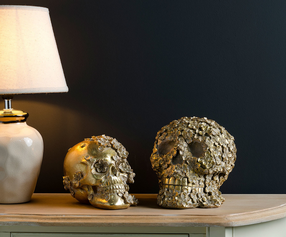 Статуэтка череп  золотого цвета