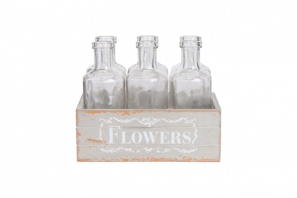 Набор стеклянных бутылок FlowersКухонные принадлежности<br>Набор из шести стеклянных бутылок оформлен <br>в искусственно состаренный деревянный <br>ящик. Этот дизайн подчеркивает красоту <br>добротно сделанной вещи, гармонично впишется <br>в интерьер кухни в стиле кантри. Размер <br>ящика: 17*12*13. Размер бутылки: 5*5*13.<br><br>Цвет: Серый, Бежевый, Прозрачный<br>Материал: Стекло, Дерево<br>Вес кг: 1<br>Длина см: 17<br>Ширина см: 12<br>Высота см: 13