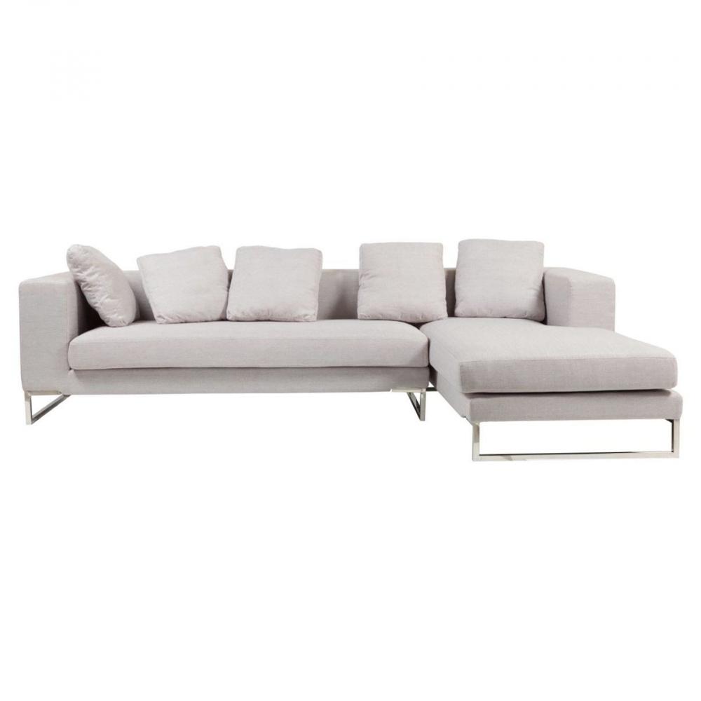 Диван Dadone Светло-серый правая секция DG-HOME Ничто не сможет лучше помочь в создании  уюта дома, чем удобный диван. Уютный диван  Dadone — это невероятно комфортный, модный  и довольно стильный от известного итальянского  дизайнера Антонио Читтерио (Antonio Citterio). Он  прибавит необычного шарма и внесет особую  теплоту вашему интерьеру. Обивка дивана  благородного серого цвета — находка дизайнеров,  она дает возможность вписаться в современный  интерьер и классический. Основание, оно  же ножки, изготовлено из нержавеющей стали  в виде прочной стальной рамы. Большие мягкие  подушки делают данную модель еще более  оригинальной. Обивка из нейлона и дизайн  позволяют дивану украсить собой современный  или классический интерьер, а мягкие подушки  дают вам возможность расслабиться с комфортом  после трудного рабочего дня. Выберите в  нашем магазине высококачественную реплику  дивана из коллекции Dadone для комнаты в современном  городском стиле: лофт, минимализм, хай-тек.