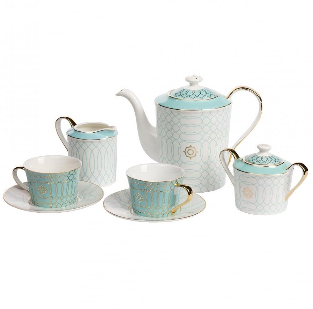Чайный сервиз Turquoise VeilЧайные сервизы<br>Утонченный и нежный чайный сервиз Turquoise <br>Veil («Бирюзовая вуаль») создает мечтательное, <br>романтическое настроение. Легкий узор словно <br>тончайшее кружево украшает набор из полупрозрачного <br>костяного фарфора. Красота и изящество <br>этого сервиза покорят самые взыскательные <br>сердца. Приятного чаепития, и пусть ваши <br>мечты станут явью! Сервиз на 4 персоны: 4 <br>пары (чашка+блюдце), молочник, сахарница, <br>кофейник (чайник).<br><br>Цвет: Золото<br>Материал: Костяной фарфор<br>Вес кг: 3<br>Длина см: 48<br>Ширина см: 34<br>Высота см: 15