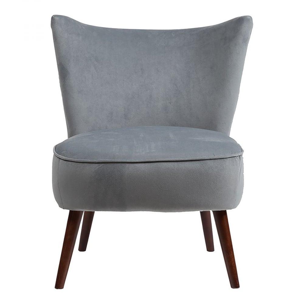 Кресло Vermont Chair Серо-синий ВелюрКресла<br>Сдержанное кресло Vermont в стиле модерн имеет <br>небольшие размеры и лаконичный дизайн. <br>Мягкое поролоновое сиденье с обивкой из <br>велюра серого цвета, высокие ножки выполнены <br>из натурального дерева тёмного орехового <br>оттенка. Кресло имеет удобную спинку, также <br>в тканевой обивке, повторяющую очертание <br>спины человека и поэтому отдых в нем будет <br>максимально комфортным.<br><br>Цвет: Серый<br>Материал: Велюр, Дерево<br>Вес кг: 8,8<br>Длина см: 62<br>Ширина см: 68<br>Высота см: 75,5