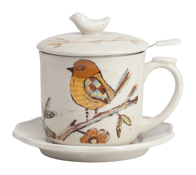Чайный набор NightingaleЧайные пары<br>Кроме цветов, изображения птиц остаются <br>наиболее распространёнными украшениями <br>всего: начиная от предметов интерьера, заканчивая <br>чем угодно. Но сейчас речь о посуде — вот <br>такой чайный набор Nightingale не просто украсит <br>кухню, но и сумеет согреть и вас, и ваш день. <br>Кружка с рисунком веселой оригинальной <br>птицы на ветке порадует вас в серый день. <br>И станет отличным подарком для человека, <br>который любит пить чай не только дома, но <br>и на работе. Набор выполнен из грубой керамики <br>белого цвета и всего включает в себя четыре <br>предмета: чашку диаметром 9 см, диаметр дна <br>составляет 6,5 см, высота 8,2 см; блюдце 14 см; <br>ситечко диаметром 9 см, диаметр крышки 9,8 <br>см, высота с крышкой 12 см. Этот позитивный <br>набор готов подарить чуть больше уюта в <br>любую погоду в любом месте. Оригинальная <br>ручка на кружке выполнена в виде птички, <br>что добавляет еще большего колорита.<br><br>Цвет: Белый<br>Материал: Грубая керамика<br>Вес кг: 0,6<br>Длина см: 14<br>Ширина см: 14<br>Высота см: 12