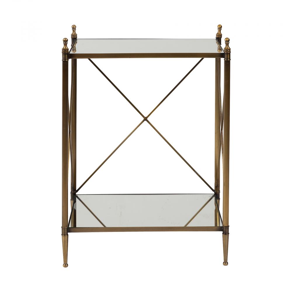 Журнальный столик Giusti DG-HOME Журнальный столик Giusti является воплощением  самых неординарных дизайнерских фантазий,  сделан настолько изящно, что им можно смело  украсить любую комнату. Его каркас выполнен  из золотистого металла, столешница и нижняя  полка выполнены из зеркального стекла.  Отдельная полка для хранения журналов,  каталогов и т.п. помогает навести порядок  и освобождает место на столе.