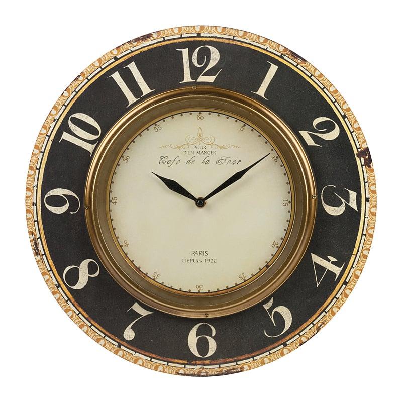 Настенные часы Cafe De La TourЧасы<br>Настенные часы Cafe De La Tour имеют кварцевый <br>тип часового механизма. Изделие выполнено <br>из металла и МДФ. Уместно выглядит в помещении, <br>устроенном в классическом, современном <br>стиле. Как предмет интерьера, часы вызывают <br>интерес людей не только своей историей <br>создания, формами, отделкой и материалом <br>изготовления. В первую очередь это — необходимый <br>в быту механизм определения времени суток, <br>а уже потом элемент декора. В данной модели <br>на первое место выходит функциональность, <br>так как автор постарался четко обозначить <br>циферблат достаточно крупными цифрами. <br>Дизайн изделия можно назвать сдержанным, <br>аристократичным, но выглядит он привлекательно. <br>Преобладающий цвет циферблата у настенных <br>часов Cafe De La Tour — черный, поэтому, размещая <br>часы в помещении, не стоит их крепить на <br>нейтральном фоне стены. Лучше повесить <br>так, чтобы на них падал взгляд входящего, <br>отмечался элегантный, почти строгий дизайн <br>и, конечно же, легко наблюдалось время. Батарейки <br>в комплект не входят.<br><br>Цвет: черный<br>Материал: МДФ, Металл<br>Вес кг: 1,2<br>Длина см: 39<br>Ширина см: 1<br>Высота см: 39