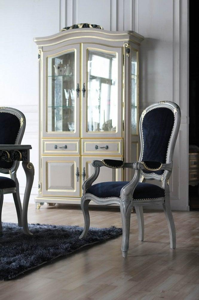 Шкаф-витрина Toscana, DFG-01Шкафы и стеллажи<br>Элегантный шкаф-витрина «Toscana» из натурального <br>дерева займет достойное место в интерьере <br>вашей респектабельной гостиной или уютной <br>столовой. Арочное остекление дверей и боковых <br>стенок, стеклянные полки и резная фурнитура <br>привлекают к себе внимание и делают помещение <br>исключительно нарядным. Витрина является <br>лучшим местом для хранения посуды, коллекционных <br>предметов, керамики, художественного стекла, <br>и просто дорогих сердцу вещей. Два выдвижных <br>ящика в нижней части предназначены для <br>столовых приборов, а полки за дверками — <br>для полотенец, скатертей и салфеток. Эта <br>мебель очень красива, чрезвычайно функциональна, <br>долговечна, качественно выполнена, и удовлетворит <br>запрос самого взыскательного покупателя, <br>в чем каждый может убедиться сам.<br><br>Цвет: None<br>Материал: None<br>Вес кг: 100