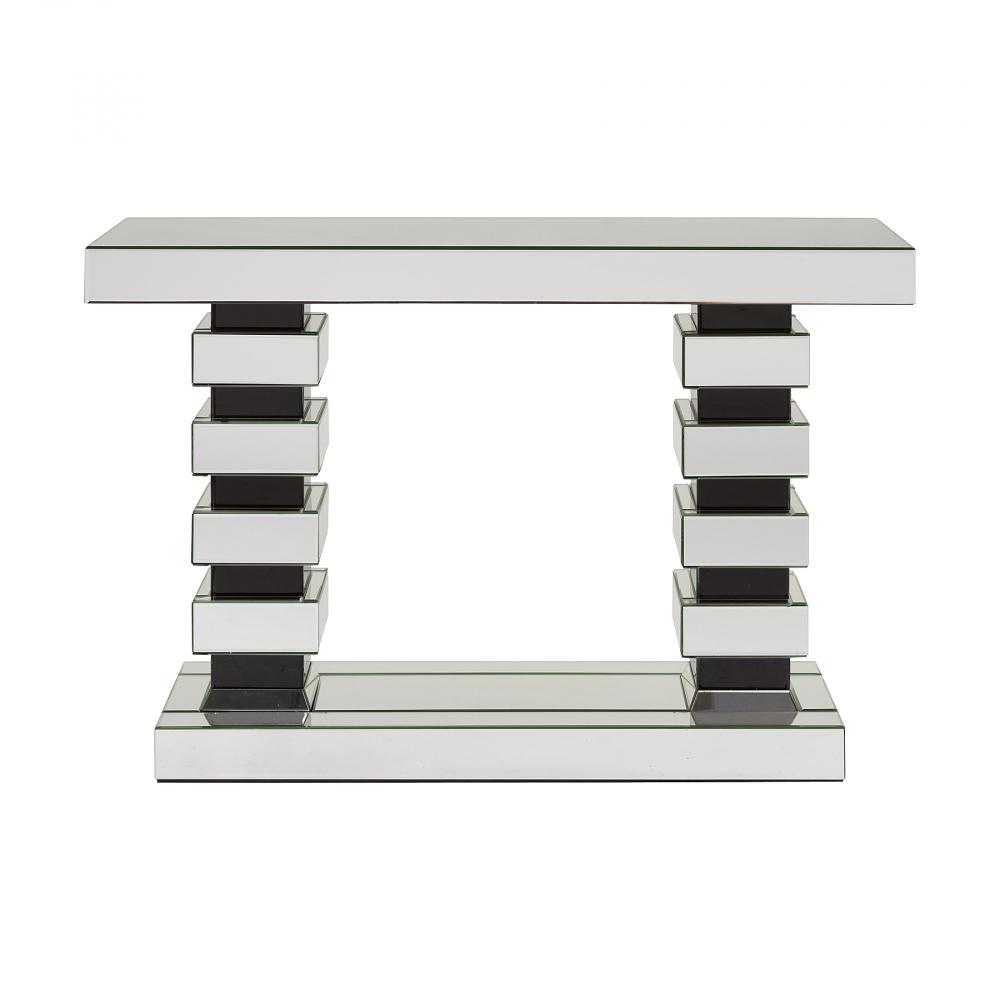 Зеркальный консольный столик NancyТуалетные столики (консоли)<br>Сразу привлечет внимание такой оригинальный <br>серебристый консольный столик Nancy на ножках <br>из прямоугольных блоков. Изделие оснащено <br>длинной зеркальной прямоугольной столешницей <br>и основанием с черными кромками. Ножки стола <br>выполнены из чёрных и серебристых с чёрными <br>кромками прямоугольных блоков разного <br>размера. Необычный современный стол-консоль <br>отлично подойдет к современному интерьеру.<br><br>Цвет: Зеркальный<br>Материал: МДФ, Зеркало<br>Вес кг: 46<br>Длина см: 120<br>Ширина см: 35,5<br>Высота см: 80