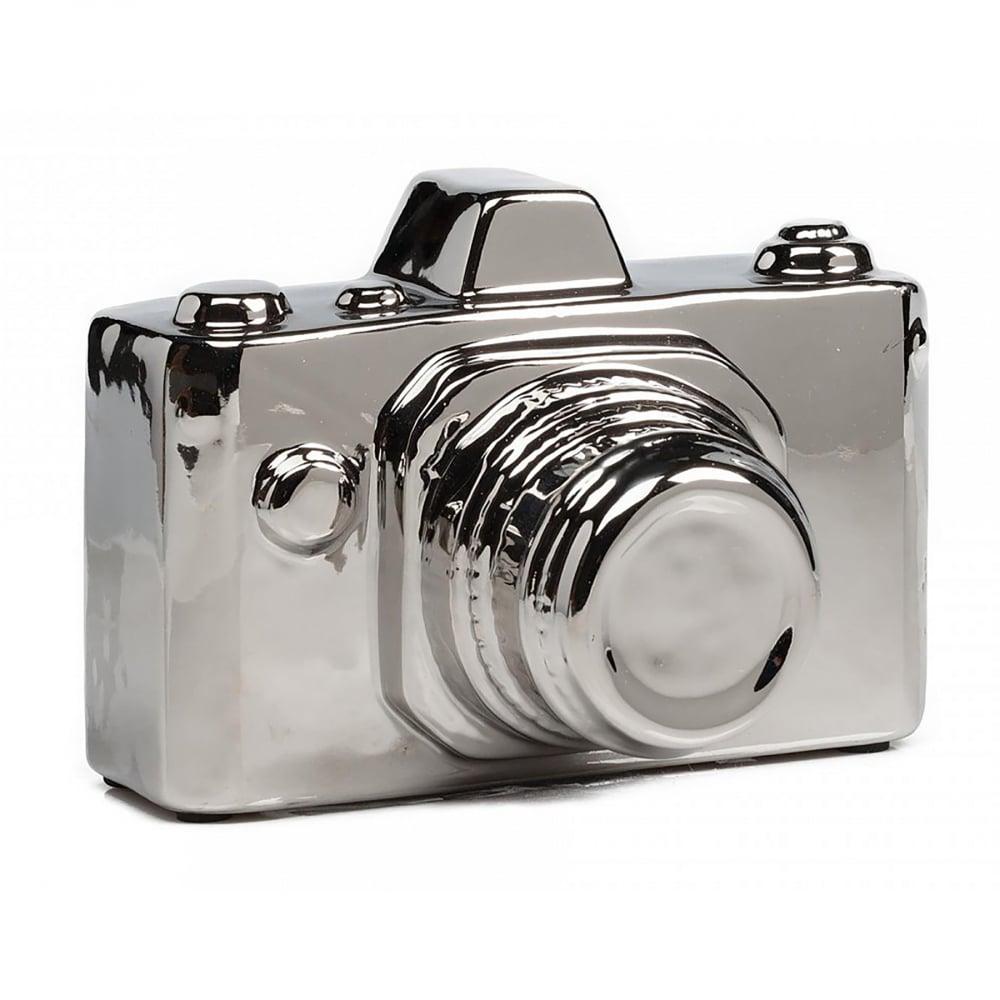 Предмет декора Camera СеребрянаяДекор для дома<br><br><br>Цвет: Серебро<br>Материал: Керамика<br>Вес кг: 0,6<br>Длина см: 15,5<br>Ширина см: 13<br>Высота см: 1