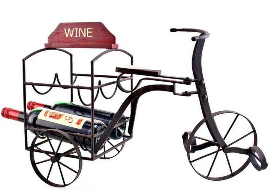 Подставка для вина La BicycletteКухонные принадлежности<br>Подставка для бутылки вина La Bicyclette — милый <br>и необходимый элемент декора, способный <br>украсить собой не только помещение в стиле <br>Прованс, но и торжественное мероприятие, <br>романтический вечер или обеденную трапезу. <br>Аксессуар выполнен из металла и имеет грубую <br>обработку металла, что придаёт ему особое <br>очарование и простоту деревенского быта. <br>Прекрасно впишется в любой интерьер любой <br>комнаты вашего дома.<br><br>Цвет: Чёрный, Красный<br>Материал: Металл<br>Вес кг: 3,5<br>Длина см: 57<br>Ширина см: 20<br>Высота см: 40