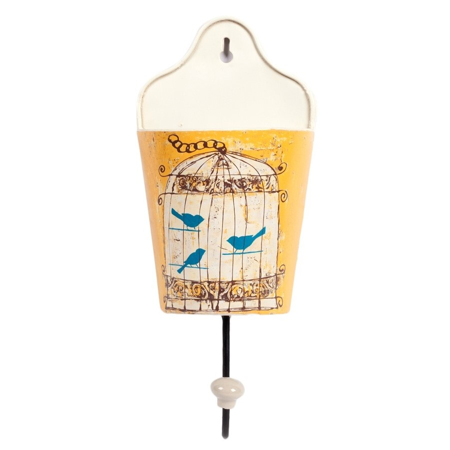 Настенный крючок Birdie In Pocket YellowДекор стен<br>Настенный крючок Birdie In Pocket — самый что <br>ни на есть провинциальный Элемент декора <br>дома в стиле Прованс, выполненный из металла. <br>жёлтый цвет элегантно подчеркнет пастельные <br>тона стен, и привнесет в интерьер яркие <br>краски. Такой крючок можно использовать <br>как в декоративных целях, повесив на него <br>милый аксессуар, так и в практических, используя <br>для бытовых нужд. В имеющийся у него кармашек <br>с рисунком птиц в клетке можно положить <br>любые мелочи, чтобы они не потерялись.<br><br>Цвет: Жёлтый, Разноцветный<br>Материал: Металл<br>Вес кг: 0,3<br>Длина см: 13<br>Ширина см: 8<br>Высота см: 29