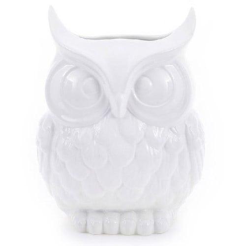 Ваза Owl IВазы<br>Эта оригинальная керамическая ваза станет <br>весьма символичным подарком. Древний символ <br>мудрости, проницательности и чуткости — <br>сова — непременный атрибут богини мудрости <br>Минервы. Таким подарком можно ненавязчиво <br>подчеркнуть ум и душевные качества коллеги, <br>друга или близкого человека. Ваза может <br>использоваться в качестве самостоятельного <br>элемента декора либо в композиции с другими <br>вазами данной коллекции.<br><br>Цвет: Белый<br>Материал: Доломит<br>Вес кг: 1,1<br>Длина см: None<br>Ширина см: None<br>Высота см: 23